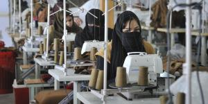 A female Afghan employee sews blankets at a textile factory, January 2017