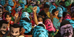 Women wearing the masks of G8 leaders join climate change protest in Dhaka. Photo: Caroline Gluck/Oxfam. CC BY-NC-ND 2.0
