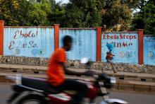 graffiti saying ebola stops with me